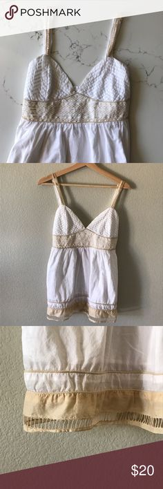{Urban Outfitters} Lucca Top Super cute white Lucca {Urban Outfitters} top. Tight around the bust and then flowy. Tan detail on the busy, straps, and bottom. Large in size. Urban Outfitters Tops