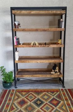 Industrial bookcase with rustic wooden tray shelves and castor wheels #industrial #bookshelf #rustic #wood #metal #theatticdubai