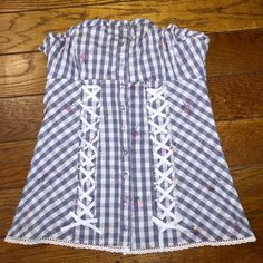 GUESS CORSET BUSTIER TOP THIS CORSET BUSTIER IS STRETCHY AND RIBBED SO IT KEEPS IT'S SHAPE. PLAID FLORAL BLUE WHITE PINK, GREAT CONDITION- NEVER WORN! Guess Tops