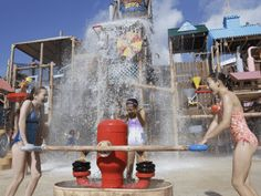 Splash Attack® is a maze of soakin' good fun with a surprise centerpiece a huge tree house with more than 50 water play toys like jets, levers, and rope pulls, plus twisting slides, bridges, cargo nets and web crawls.