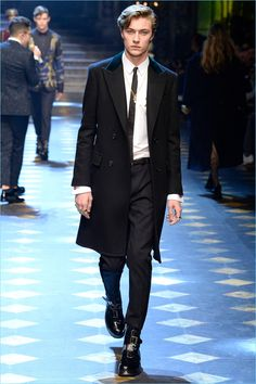 Lucky Blue Smith wears a sleek black and white look from Dolce & Gabbana.