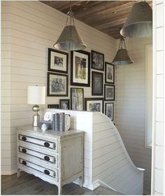 Perfection.  Lighting.  banister. paneled walls.