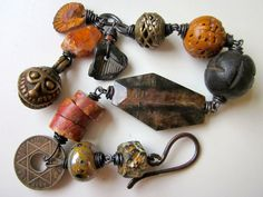 Among the Ruins - primitive assemblage rusty orange ceramic art beads, stone nuggets, fossil, trade beads, bauxite, & copper charm bracelet by LoveRoot, $74.00