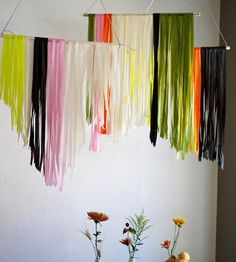 These colorful hanging panels are perfect for dressing up your holiday table or for giving your room a modern burst of color. Strips of tissue paper are cut and artfully draped on a wooden dowel. Each panel is 3 ft wide and approx. 2.5 ft long.
