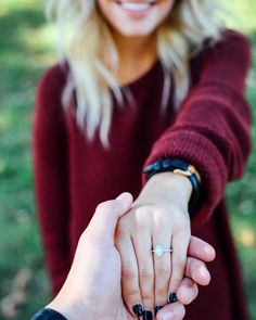 Omigosh! I love this so much better than her simply showing the camera the ring, this is him holding her hand as if it is more him then her showing the camera the beautiful ring symbolic of their commitment to get married.
