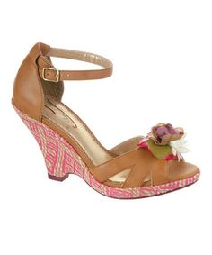 Tan True Romance Wedge by Poetic Licence $34.95 Coral & a Flower Accent Give the Shoe a bit of Color  3.5'' heel Buckle closure Leather upper Man-made sole