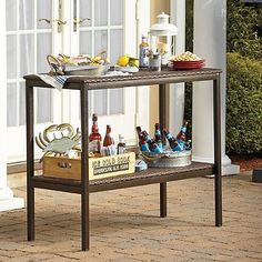 Outdoor Buffet Serving Table from Stratford, Features 2 Durable Shelves Made of All-weather Wicker and Durable Rust-resistant Steel Frame, Ideal for Dining Out in Patio and Porch Area Outdoor Buffet, Outdoor Tables, Outdoor Decor, Patio Furniture Covers, Garden Furniture, Porch Area, Metal Dining Table, Serving Table, Patio Seating