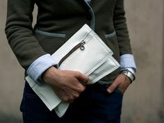 A medium clutch bag, made of white thick leather. Close with zip, with two pockets on cards. No lining. Dimesions: height: 32 cm/ 12,5 witdht: 26 cm/ 10   For these bag, please expect 1 week for your item to be made and prepared for shipment!  Standard delivery time:  European union: 4 - 10 days  Europe (not EU): 7 - 14 days  U.S.A., Canada: 10 - 20 days  Australia, South America, Asia, India, North Africa: 1 - 3 weeks  We send all items with priority air mail and tracking number.