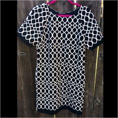 """NWOT B&W Taylor dress Classic b&w dress from Nordstrom. Perfect for any occasion. Picture one shows the front & picture 2 is the back of the dress. Head to toe length is 34.5"""", sleeve length is 12"""". Hidden zipper up back. Excellent condition. Taylor Dresses Midi"""