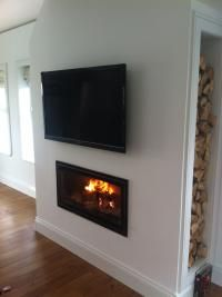 Insert stove surround with built-in log storage. Insert Stove, Modern Fireplaces, Diy Home Improvement, Stoves, Wood Burning, Design Ideas, House Design, Interiors, Living Room