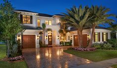 A sleek stucco exterior, elegant paver-stone driveway and convenient front- and side-entry garages welcome guests to this exquisite Kingsmill home in beautiful Boca Raton, FL. Built by Richmond American.