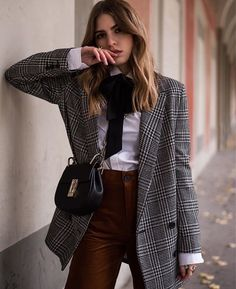 Love the contrasting bow blouse.