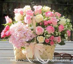 Basket flowers - pink flowers - http://saigonflowersgifts.com