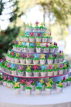 Spring party- cupcakes (white fence with mini pinwheels)