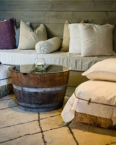 Linen covered hay bales topped w/ pillows and wine barrel tables; Napa Valley
