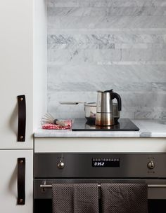 The kitchen features a Smeg oven and Ramblewood induction range.