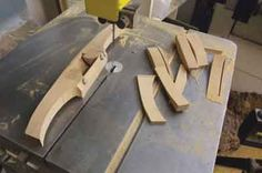 A template is used to mark this out and the remaining shape is cut freehand with anarrow quarter-inch-wide blade on the bandsaw