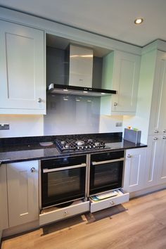 Kitchen Style – Second Nature Fitzroy in Partridge Grey, with Angolan Black granite worktops, up-stands and window sill. With two Neff Hide&Slide Pyrolytic ovens, Neff Hob and Extractor hood. Completed with Slate glass splash back and matching utility room.