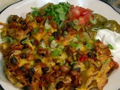 Chicken Chili Frito Pie. We just watched this on Diners, Drive-Ins and Dives and had to google immediately.