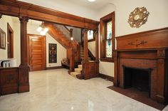 Grand Entry Foyer features Historic Woodwork & Period Lighting. Walk through Living Room w/ Refinished Hardwoods and Stunning Fireplace & into Dining Room w/ Ornate Built-in Hutch. Comforta…