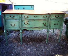 Antique buffet--leggy and a wood top like this but different paint treatment.