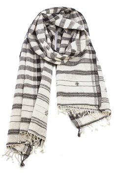 This is the perfect summer scarf that you could continue to wear in the fall. Pair with a simple white tee and ripped denim jeans for a chic french inspired look.