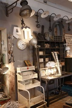 great light fixtures and tons of storage bins with treasures tucked away   |   via Modern Country