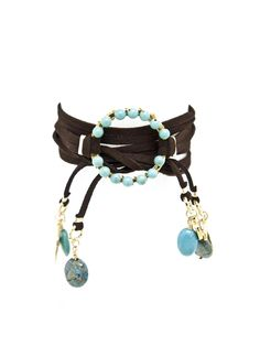 Suede & Turquoise Charm Wrap. I've been trying to make a gift for my fellow nickel-allergy suffering sister-in-law's birthday, and this seems like it would be fairly easy to substitute wood and natural gemstones for the metal pieces in this. It's something she'd wear, too.