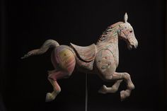 Haroshi layers recycled skateboard decks to produce fantastic mosaic-like sculptures.