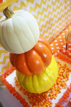 Throw a Candy Corn themed party by using the cutest printable set. This party is decked out with chevron and polka dot prints, and of course, candy corn! Check it out.