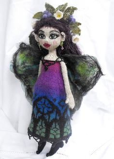 """Kerani Fairy  Hand knit by Jeanne Lawrence  with nuno felted wings   Based on """"Knitted Fairies to Cherish & Charm"""" by Fiona McDonald."""
