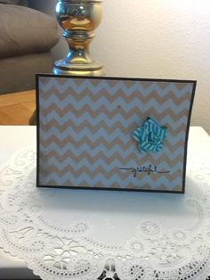 """5.5"""" X 4.5"""" Chocolate Brown handmade greeting card (blank inside) featuring Stampin' Up """"Grateful"""" stamp. Background is textured, glittery, amber chevron stripes. The back of the card features a signature stamp from the author. Author contact at creationsbyessie@gmail.com"""