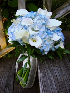 Wedding bouquets:  bride- purple hydrangeas. Bridesmaids- darker blue hydrangeas and daisies instead of clla lillies