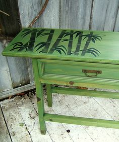 table stenciled with hand cut bamboo stencil design.