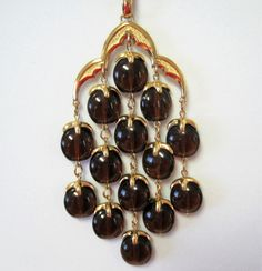 Crown Trifari waterfall pendant necklace featuring a waterfall of tortoiseshell lucite.  From the ea