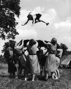 Girl guides 100th: 1955 tossing in a blanket at the annual Girl Guide Camp
