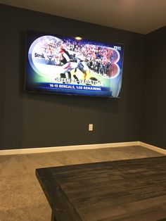 Black accent wall great for watching the game in the newly finished basement.