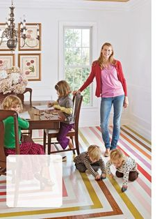 colorful painted stripes on the floor! / via better homes and gardens