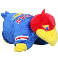NCAA Kansas Jayhawks Pillow Pet by Fabrique Innovations. $29.99. Licensed product!. Felt applique detailing. Quality embroidery. Plush pillow with foam filling. Hook & loop fastener to stand upright. Cuddle and snuggle with the Kansas Jayhawks Pillow Pet by Fabrique! This unique and original pillow pet features your favorite team logo and colors in the shape of a mascot or unique animal.  Just unfasten its belly and the pet becomes an 18 inch pillow. Made of hi...
