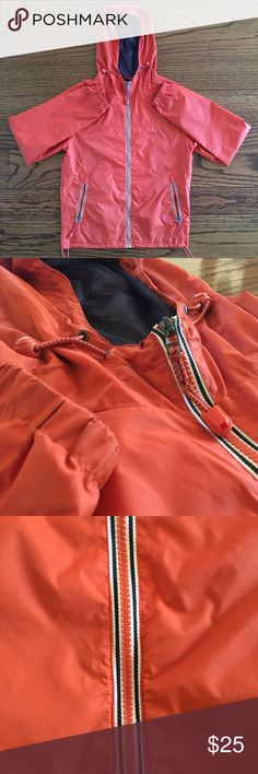 Mens Windbreaker - Next size small Great condition. Tangerine colored Windbreaker great to pack for a trip of wear around town. Size small next Jackets & Coats Windbreakers
