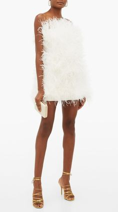Really be the life of the party with this strapless feathered mini wedding dress from The Attico. Choose this short dress for a flirty twist on the feather wedding gown trend for your spring or summer wedding. Itd even make the perfect rehearsal dinner dress! Here are 19 other unique short wedding dresses. // Photo: Matches Fashion