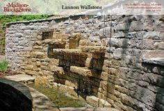 Snapped-face Lannon wallstone is built as a retaining wall and waterfall combo.