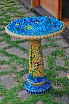 I used to make these mosaic birdbaths.  This one is beautiful.