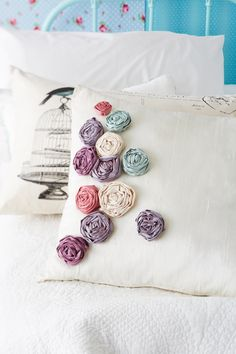 Scatter cushion with fabric roses tutorial - Lovely idea & tutorial. www.seamstar.co.uk