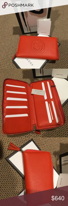 """NWT Gucci Orange Leather Zip Book Wallet Gucci offers the hottest designs this season & this gorgeous orange grained leather wallet is something you ll use daily .  This NWT book wallet unzips and opens flat is perfect for those who crave organization or just need it. Features Gucci's tasseled zipper pull,16 credit card slots, 2 sections, zippered coin sects, 2 currency slots, 2 extra wide opening sections.  Could warily zip your phone into the wallet and use as a small handheld clutch.  8""""…"""