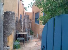 Blue door, parking area, Visit Santa Fe, The City Different, October is beautiful in Santa Fe - aspen leaves and cool, dry air and bright blue skies. Cozy and historic adobe home in town - walking distance to the plaza. SF vacation rental available Oct 16 - 20 and Oct 26- Nov 04, https://www.airbnb.com/rooms/2562597 #santafevacationrental