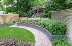Tuin met niveauverschil Ede | Hortus NovusHortus Novus Sidewalk, New Homes, Gardens, House, Image, Home, Side Walkway, Outdoor Gardens, Walkway