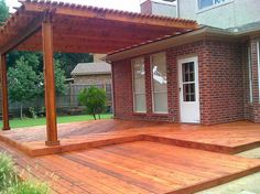 Backyard deck ideas for the house red brick walls, deck stai Deck Stain Colors, Deck Colors, Arcade, Deck Finishes, Burgundy Living Room, Red Brick Walls, Outside Patio, Decks And Porches, Pergola Designs