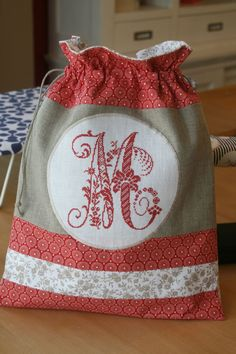 would be so pretty for a 'shoe bag' when going to the masjid Embroidery Letters, Embroidery Works, Cross Stitch Designs, Cross Stitch Patterns, Cross Stitching, Cross Stitch Embroidery, Cross Stitch Finishing, Cross Stitch Alphabet, Fabric Bags