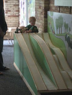 Car Ramps. I had a parent to make me a smaller scale one. We put it outside and everyone loves it.